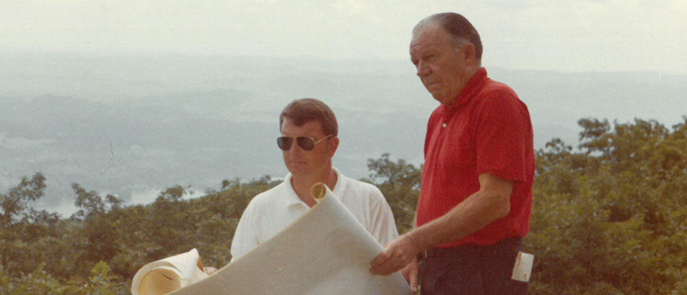 Howerdd Sr. and Howerdd Jr looking over golf course plans